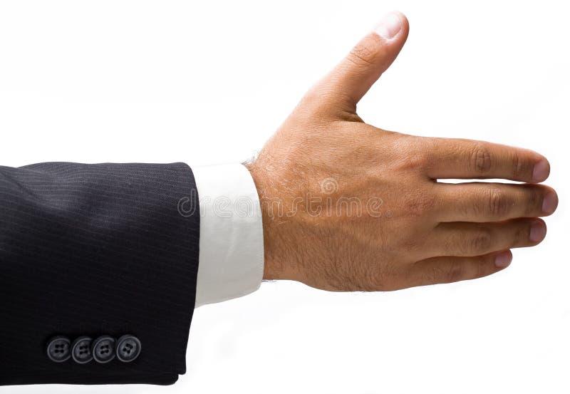 La main de l'homme d'affaires étendu pour une prise de contact. images stock