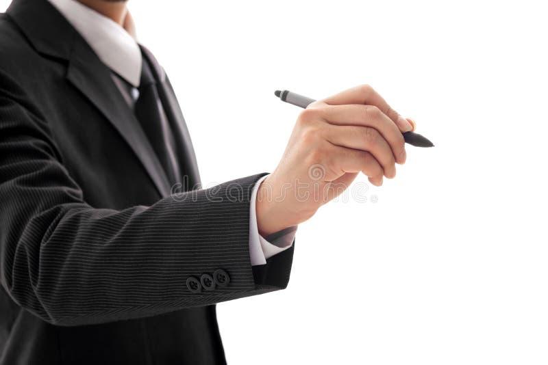 La main de l'homme d'affaires tenant Pen Isolated sur le fond blanc photo stock