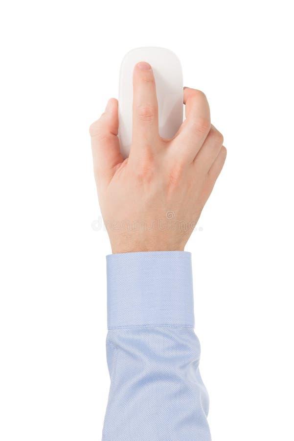 La main de l'homme dans une chemise sur une souris en verre sans fil moderne de contact. photographie stock libre de droits
