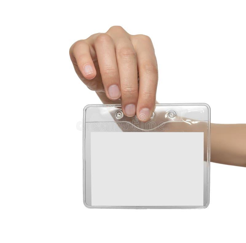 La main de la femme montrant le badge nominatif vide photo libre de droits