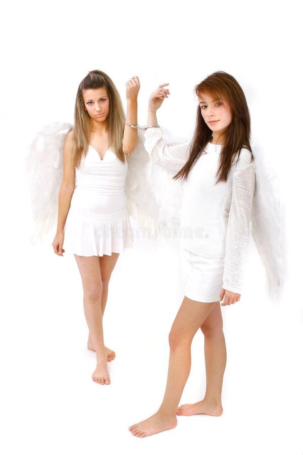 La main deux a giflé des anges image stock