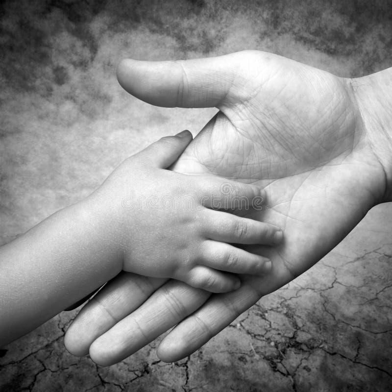 La main du père images libres de droits