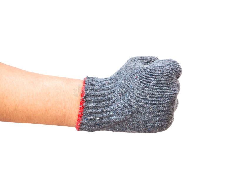 La main enfilée de gants de travailleur révèlent le poing droit d'isolement images stock