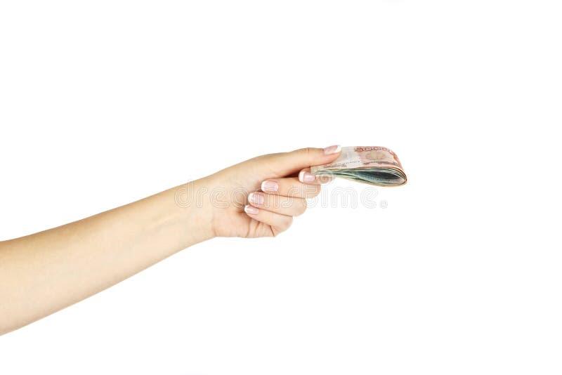La main femelle tient l'argent russe sur un fond blanc images libres de droits