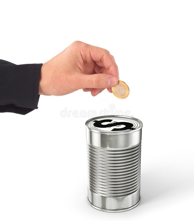La main mettant la pièce de monnaie en le dollar peut images libres de droits