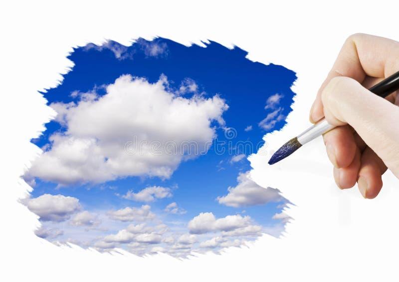 La main peint le ciel photographie stock