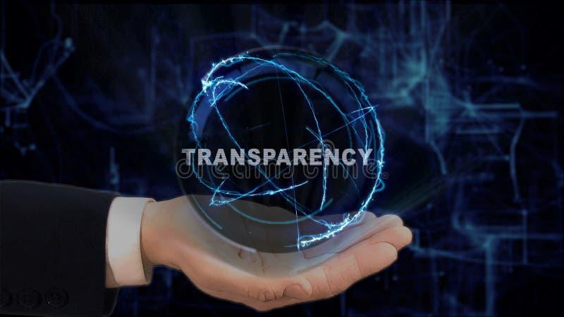 La main peinte montre le transparent d'hologramme de concept sur sa main images stock