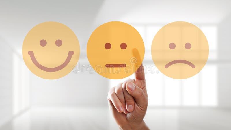 La main sélectionne un smiley neutre d'humeur images libres de droits