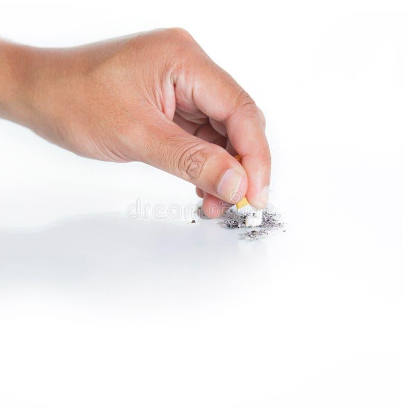 La main s'est éteinte une cigarette photos stock