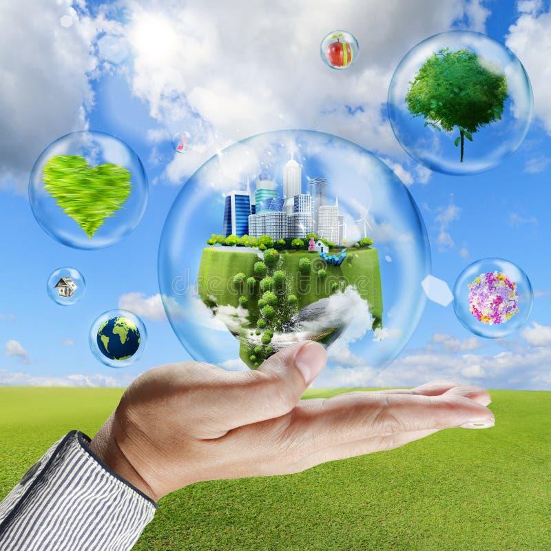 La main tient des bulles avec la collection d'affaires à l'intérieur illustration stock
