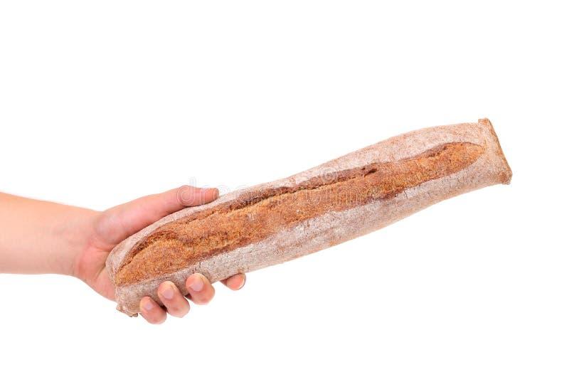 La main tient le long pain photo libre de droits