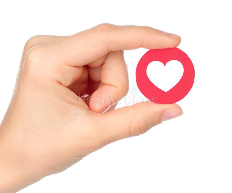 La main tient la réaction compréhensive d'Emoji d'amour de Facebook images stock