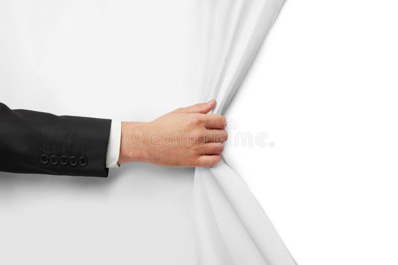 La main tourne le papier images libres de droits