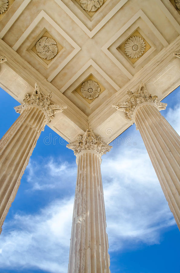 La Maison Carrée. Maison Carrée, an example of Vitruvian architecture, it is one of the most well preserved Roman structure. It is located in Nimes, France royalty free stock photo