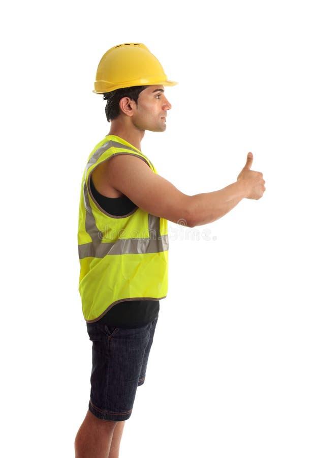 La manitas del trabajador de construcción manosea con los dedos para arriba imágenes de archivo libres de regalías