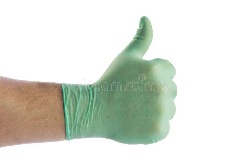 la mano aislada en guantes médicos del fondo blanco muy bien firma fotos de archivo libres de regalías