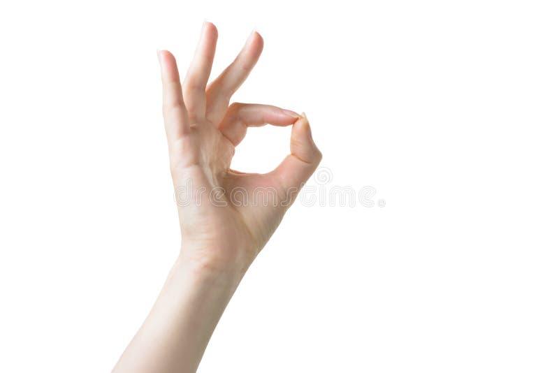 La mano con il segno pallido di approvazione della pelle su bianco ha isolato il fondo fotografia stock