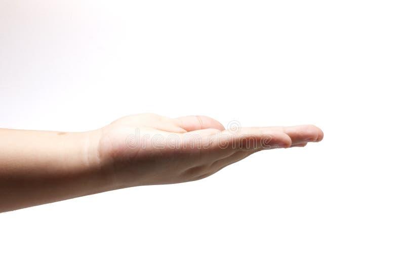 La mano de la muchacha que lleva a cabo algo imagen de archivo libre de regalías