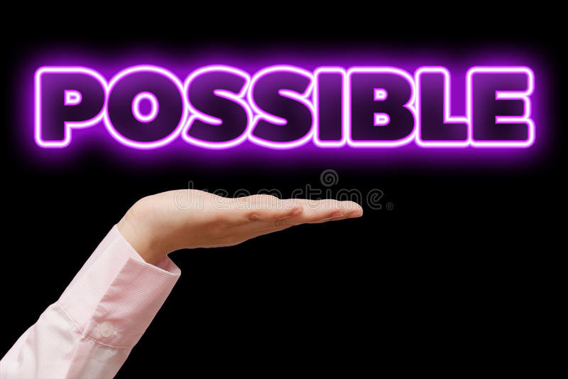 La mano de la mujer de negocios ahuecó llevar a cabo la palabra POSIBLE con la luz de neón púrpura violeta fotos de archivo libres de regalías