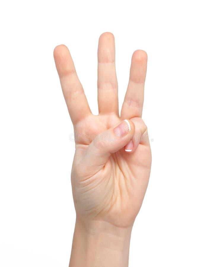 La mano de la mujer muestra el número tres imágenes de archivo libres de regalías