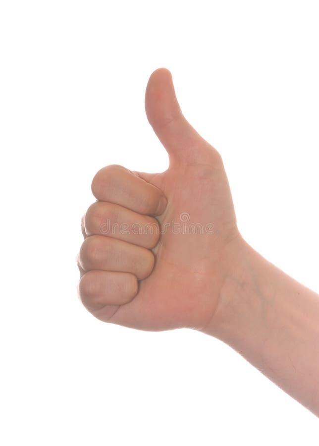 La mano de los hombres formados pozo hace los pulgares para arriba imagen de archivo libre de regalías