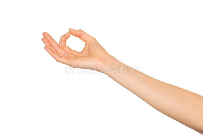 La mano de la mujer con el pulgar y el índice unidos fotografía de archivo
