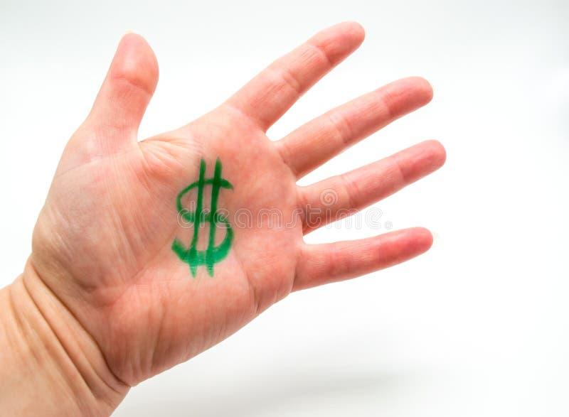 La mano de la mujer con la muestra de dólar dibujada en la palma aislada en blanco fotografía de archivo