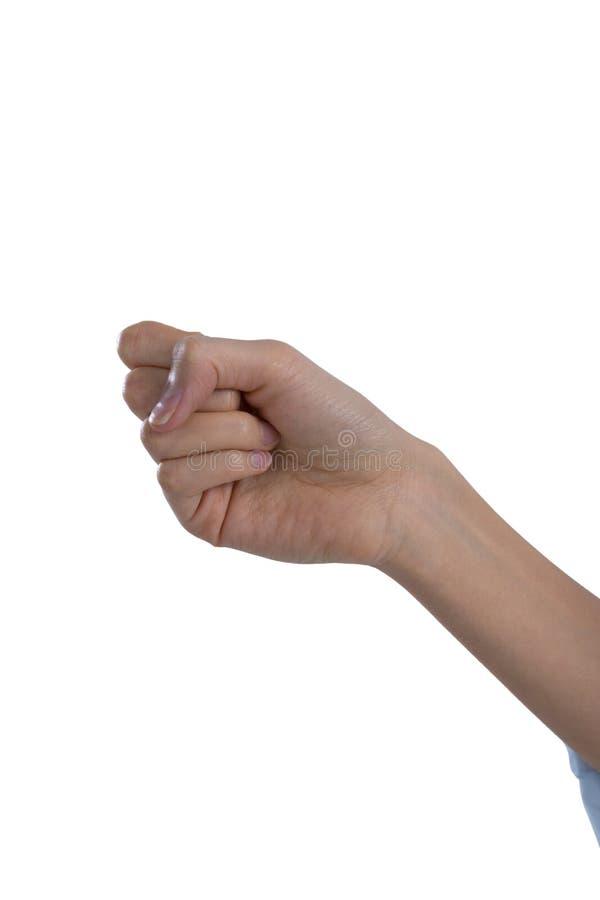 La mano de la mujer que forma el puño imagen de archivo