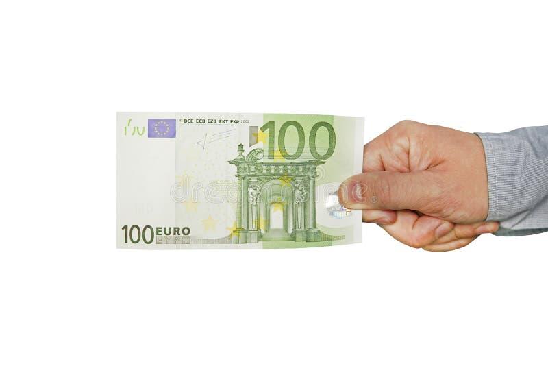 La mano de un hombre sostiene cientos billetes de banco del euro 100 euros imagen de archivo