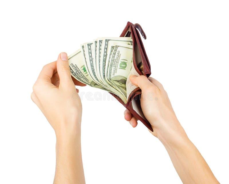 La mano degli uomini ottiene i dollari da una borsa immagini stock