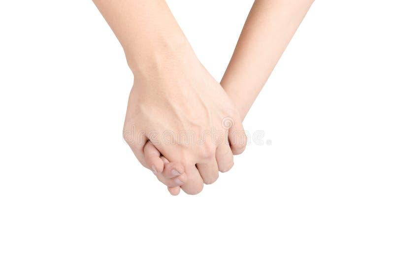 La mano del figlio della tenuta della madre isola insieme su fondo bianco immagine stock libera da diritti