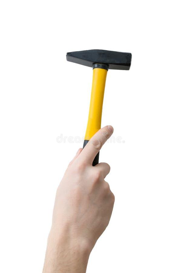La mano del hombre de los caucásicos sostiene el martillo Concepto de mantenimiento fotos de archivo