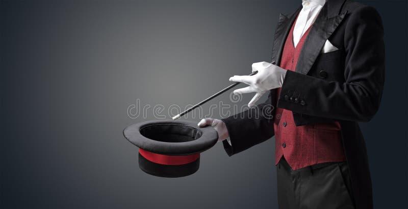 La mano del ilusionista quisiera que s conjurara algo imagen de archivo