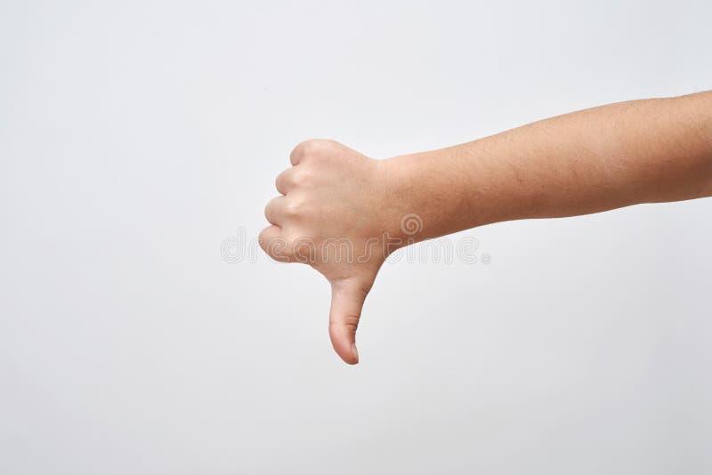 La mano del niño muestra golpe abajo Muestra del desacuerdo y desemejante negativos imagenes de archivo