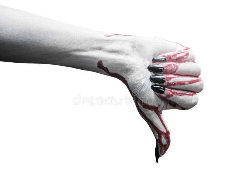 La mano del vampiro con il pollice giù gesture fotografia stock