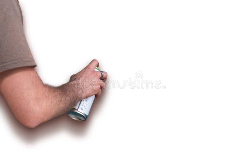 La mano dell'artista con la pittura di spruzzo fotografia stock