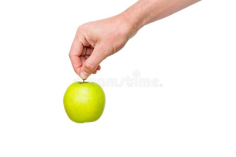 La mano dell'uomo che tiene mela verde fotografia stock