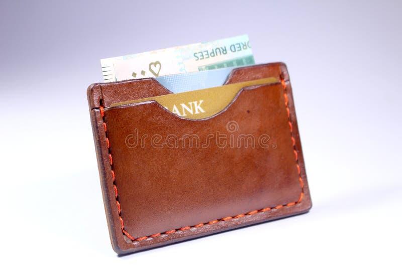 La mano di cuoio del portafoglio ha cucito il marrone fatto a mano immagine stock libera da diritti