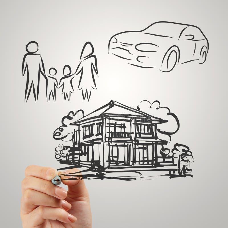 La mano disegna il futuro della famiglia di pianificazione immagini stock