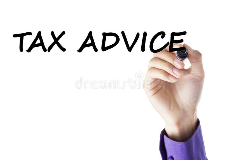 La mano escribe consejo del impuesto imagen de archivo libre de regalías