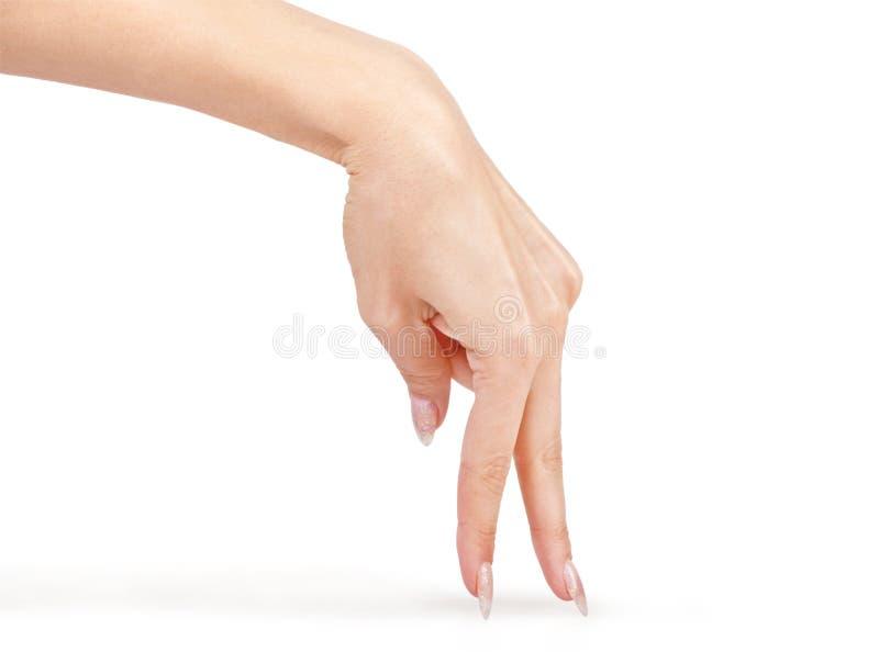 La mano está mostrando los fingeres que caminan aislados fotografía de archivo libre de regalías