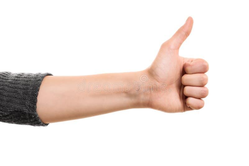 La mano femenina que hace los pulgares sube gesto imagen de archivo libre de regalías
