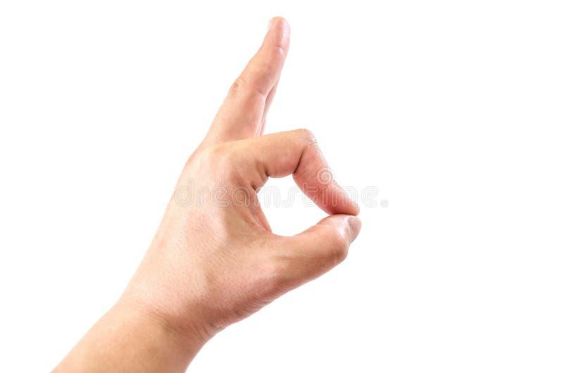 La mano femminile mostra okay isolato su un fondo bianco Primo piano fotografia stock