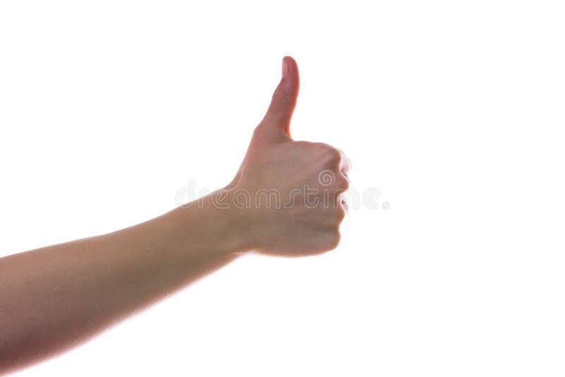 La mano femminile sfoglia sul segno giusto immagini stock