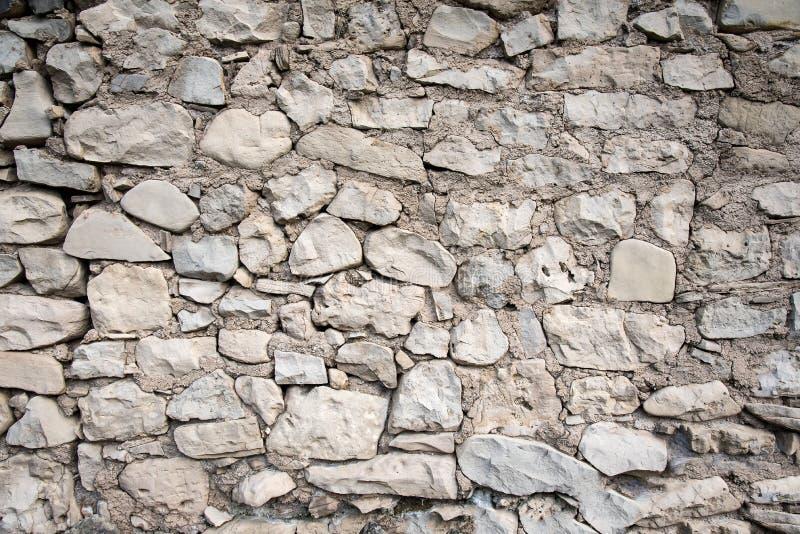La mano grigia ha costruito la parete di pietra fotografia stock