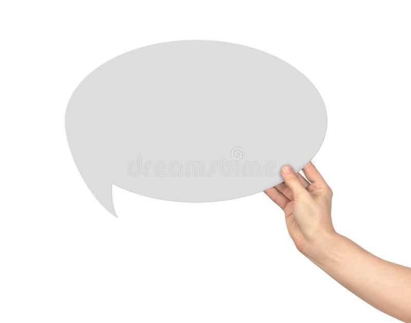 La mano lleva a cabo un diálogo fotografía de archivo libre de regalías