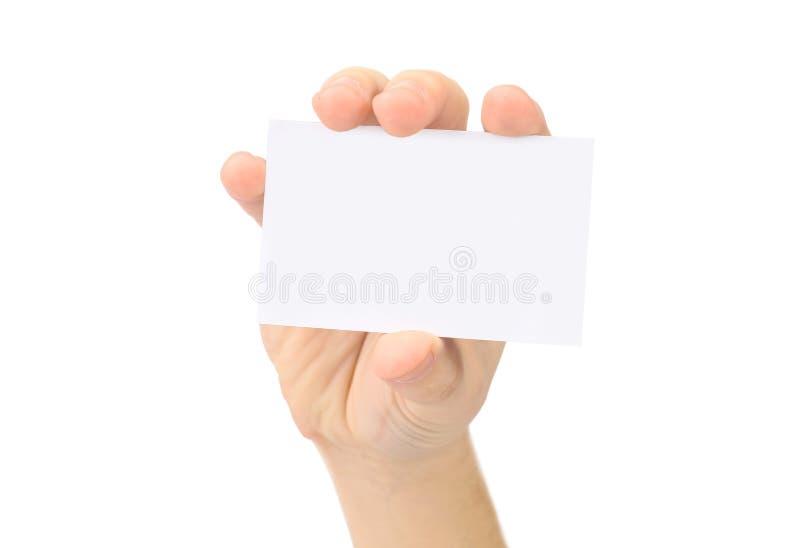 La mano muestra la tarjeta de visita en blanco foto de archivo