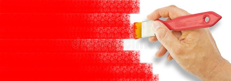 La mano pinta con color rojo en un fondo blanco usando un cepillo - imagen del concepto con el espacio de la copia stock de ilustración