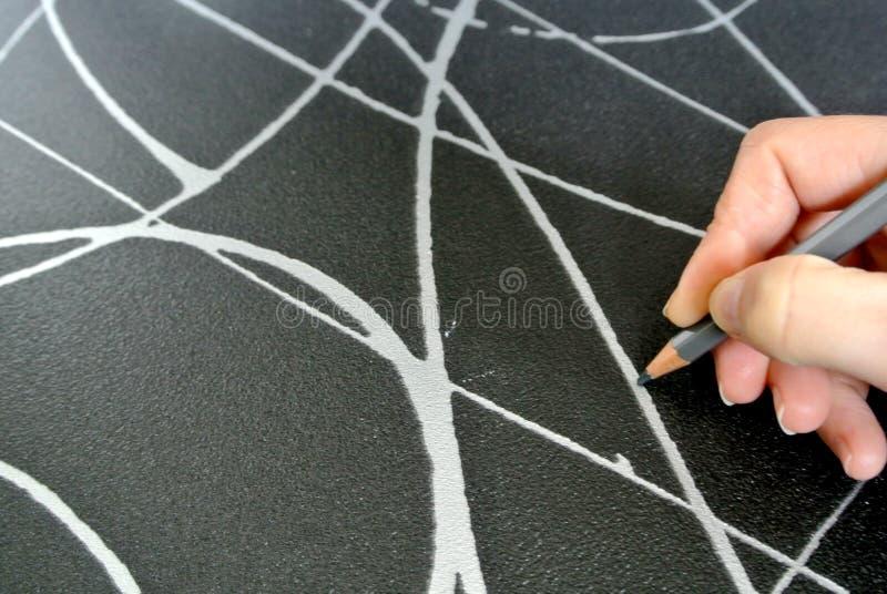 La mano que dibuja foto de archivo libre de regalías