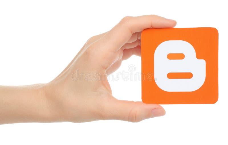La mano tiene il logotype di blogger fotografia stock libera da diritti